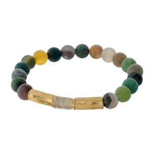 Natural stone beaded stretch bracelet with a gold tone hammered, bar focal.