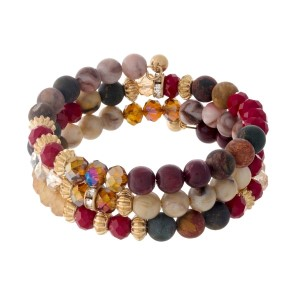 Burgundy, picture jasper and mauve beaded coil bracelet with gold tone accents.