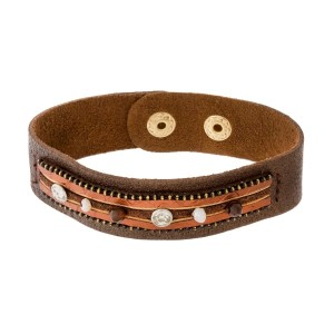 Genuine leather bracelet with a beaded and animal print focal and a snap closure.