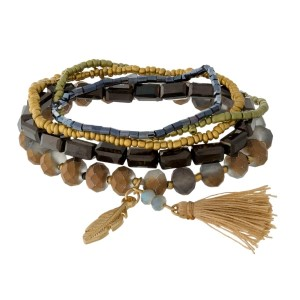 Multi-strand beaded stretch bracelet set with gold tone feather charms.