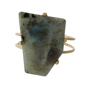 Gold tone cuff bracelet with a natural stone focal.