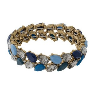 Gold tone stretch bracelet with teardrop rhinestone and epoxy stones.