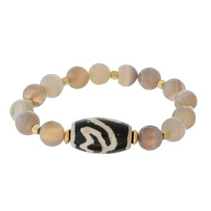 Natural stone beaded stretch bracelet with gold tone accents and a bohemian bead focal. Handmade in the USA.