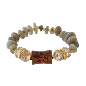 Natural chip stone stretch bracelet with gold tone accents and a rust orange bohemian bead.