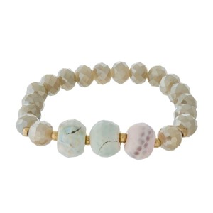 Beaded stretch bracelet with natural stone accent beads.
