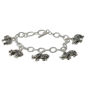 Silver tone charm bracelet with elephant charms and a toggle closure.