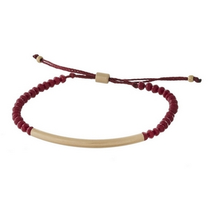 Dainty, pull-tie, beaded bracelet with a metal bar focal.