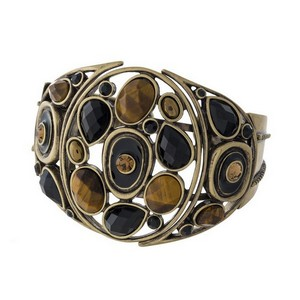 Burnished gold tone cuff bracelet with tiger's eye and black stones.