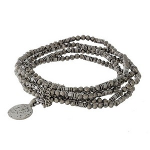 Five piece, silver tone stretch bracelet with a hammered circle charm.