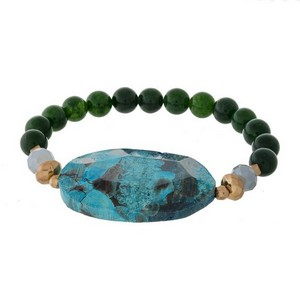 Natural stone beaded stretch bracelet with an agate cut stone focal.