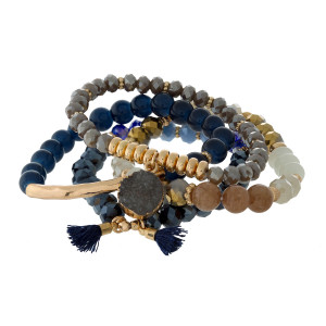 Four piece stretch bracelet set with gold tone accents and a faux druzy stone charm.