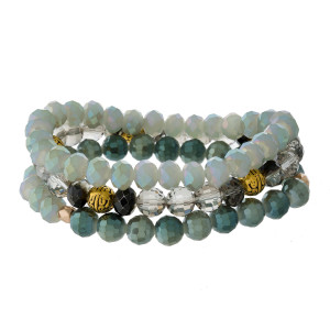 Three piece, stretch bracelet set with gray and green beads, and burnished gold tone accent beads.