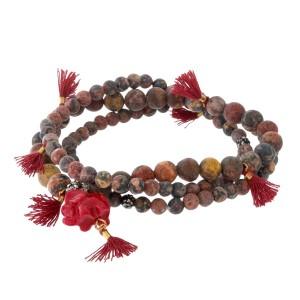 Three piece, natural stone beaded stretch bracelet with an elephant charm.