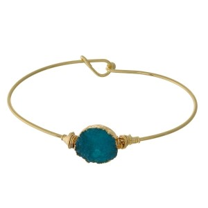Dainty gold tone bangle bracelet with a faux druzy circle stone focal.