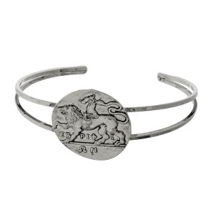Burnished metal cuff bracelet with a coil focal.
