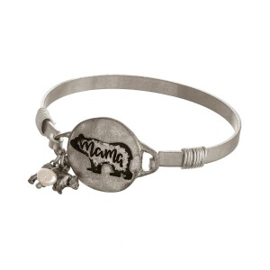 "Burnished metal, bangle bracelet stamped with a ""Mama Bear"" circle focal."