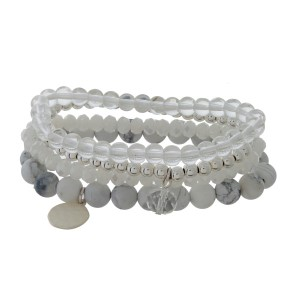 Four piece stretch bracelet set with faceted and natural stone beads and a hammered circle charm.