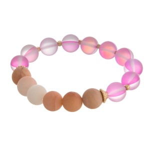 Natural stone and iridescent beaded stretch bracelet with gold tone accents.
