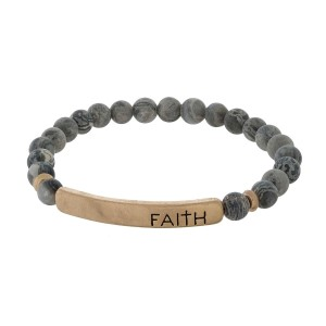 "Beaded stretch bracelet with a bar focal, stamped with ""Faith."""