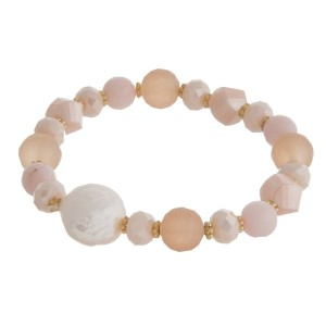 Glass and natural stone beaded stretch bracelet with a freshwater pearl bead accent.