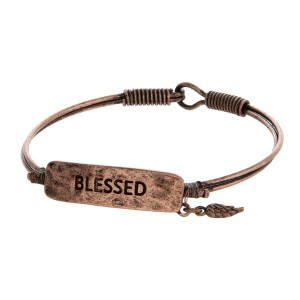"Burnished, bangle bracelet with a focal stamped with ""Blessed."""