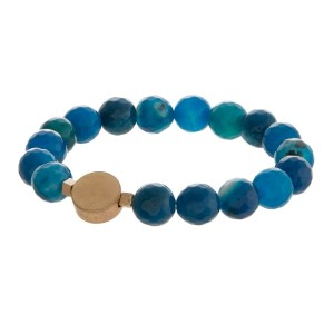 Natural stone stretch bracelet with gold tone accents.