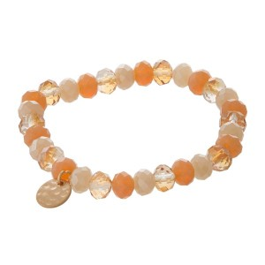 Stretch bracelet with faceted beads and a hammered circle pendant.