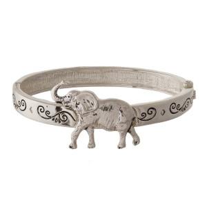 Metal hinge bracelet with elephant focal.