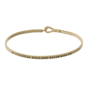 """Metal bracelet with engraved message, """"Be Strong, Be Bold, and Never Give Up."""""""