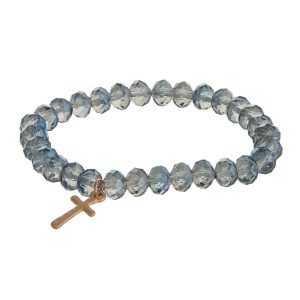 Stretch bracelet with faceted beads and cross charm.