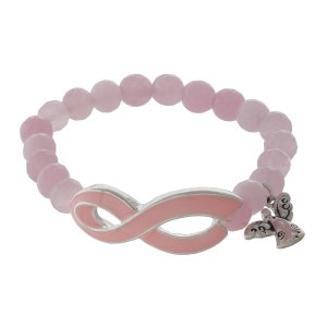 Stretch bracelet with breast cancer awareness ribbon.