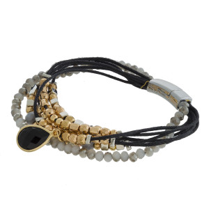 Beaded magnetic bracelet with waxed cord and faceted beads.