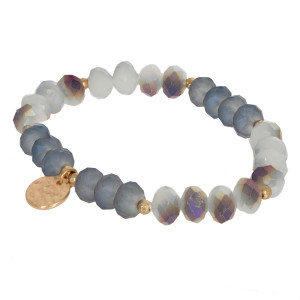 Faceted bead stretch bracelet with gold charm.