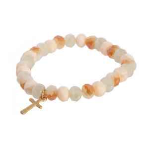 Faceted bead stretch bracelet with cross charm.