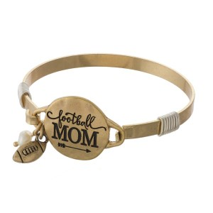 Metal bracelet stamped with football mom.