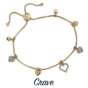 Adjustable metal bracelet with charm detail.