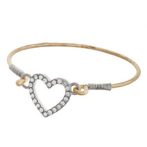 """Metal cuff bracelet with rhinestones and heart pendant. Approximately 2"""" in diameter."""