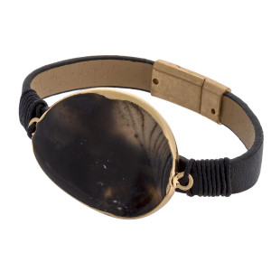 "Leather bracelet with magnetic closure with natural stone wrist details. Approximate 8"" in length."