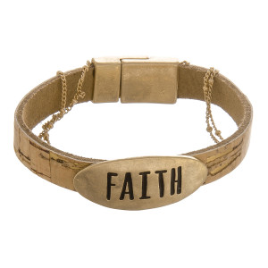 "Cork bracelet with metal clasp and a ""Faith"" pendant and gold details. Approximately 6"" in length."