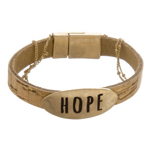 "Cork bracelet with metal clasp and a ""Hope"" pendant and gold details. Approximately 6"" in length."