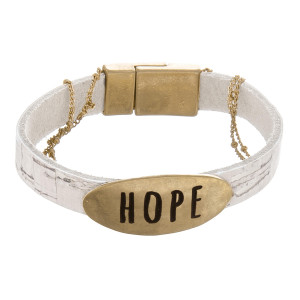 """Cork bracelet with metal clasp and a """"Hope"""" pendant and gold details. Approximately 6"""" in length."""