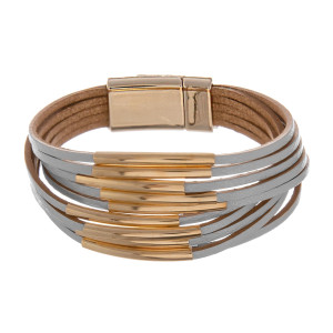"Leather multi string bracelet with gold metal wrist details. Approximate 8"" in length."
