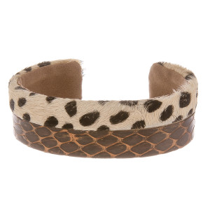 """Leather bracelet with animal print detail. Approximate 2.5"""" in diameter."""