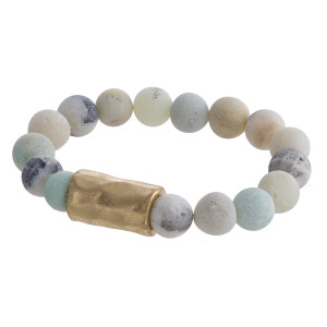 "Natural stone stretch bracelet with gold wrist details. Approximate6"" in length."