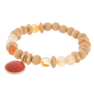 """Natural stone stretch bracelet with wood bead detail and natural stone charm. Approximate 6"""" in length."""