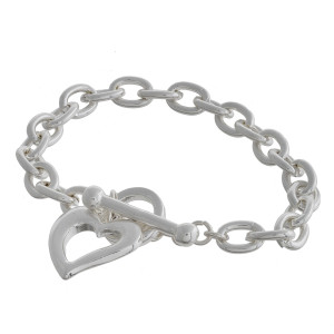 "Metal chain linked bracelet with heart charm. Approximate 6"" in length."