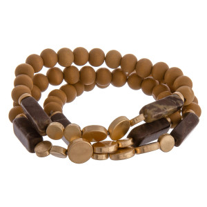 """Multi strand natural stone bracelet with wood and beads. Approximate 6"""" in length."""