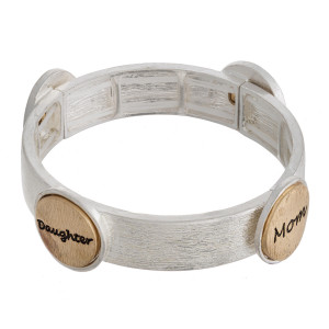 "Metal stretch bracelet featuring ""Mom & Daughter"" engraved focal accents. Approximately 2.5"" in diameter unstetched. Fits up to a 5"" wrist."