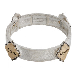"Metal stretch bracelet featuring ""Mom & Son"" engraved focal accents. Approximately 2.5"" in diameter unstetched. Fits up to a 5"" wrist."