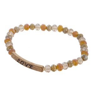 """Beaded stretch bracelet with """"Love"""" message. Approximate 6"""" in length."""